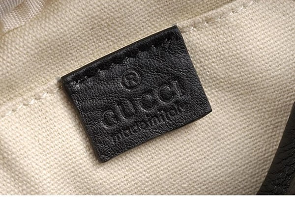 Gucci logo embroidered inside the bag