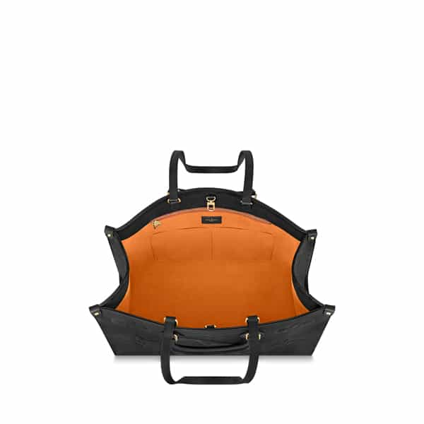 The inner compartment is lined in brilliant orange red