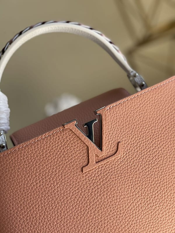 The LV logo is sheathed in calf leather